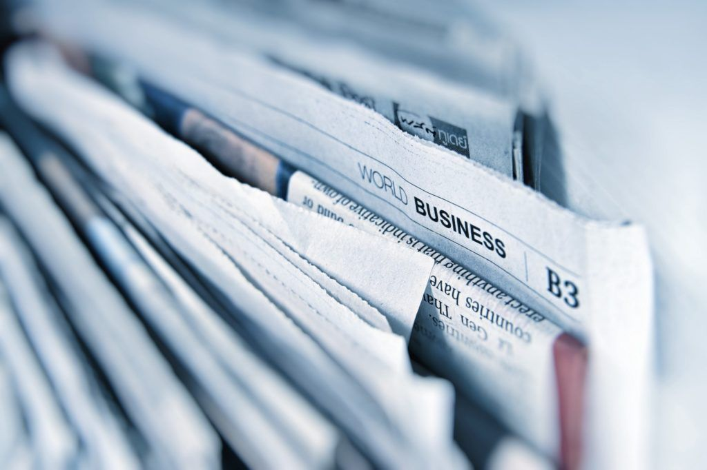 """Close up view of folded newspaper with the B3 section in focus titled """"World Business"""""""